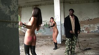 Filthy outdoors BDSM scene with slave girls Lucky and Lucie Lee