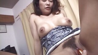 Japanese wife Marie Sugimoto gets her pussy fucked in missionary