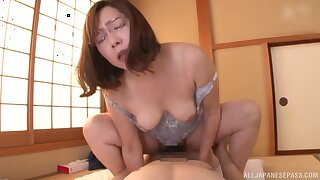 Cramped amateur Japanese mature rides the cement like she's 19 again