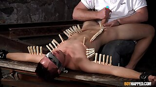 Clamped twink endures master's dirty fetishes until the repeal